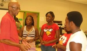 Students greet Mr. Thomas Tatum.